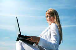 Blondie with laptop Royalty Free Stock Photo