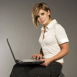 Blondie with laptop Stock Photo