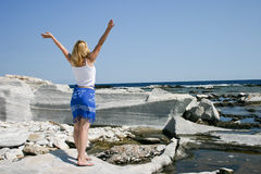 Blondie on marble beach. Beautiful Blondie on marble beach, Thassos island, Greece Stock Image