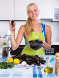 Blondie posing with fresh mussels Royalty Free Stock Image