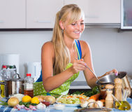 Blondie preparing veggies in kitchen Royalty Free Stock Photo