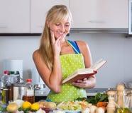 Blondie preparing veggies in kitchen Royalty Free Stock Images