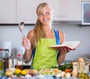 Blondie preparing veggies in kitchen Stock Photos