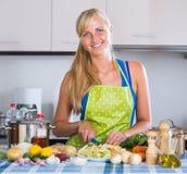 Blondie preparing veggies in kitchen Royalty Free Stock Photography