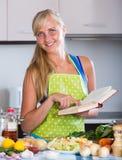 Blondie preparing veggies in kitchen Stock Photo