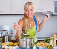 Blondie preparing veggies in kitchen Stock Photography