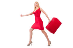 Blondie in red dress with suitcase isolated on Royalty Free Stock Photography