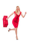 Blondie in red dress with suitcase isolated on Royalty Free Stock Images