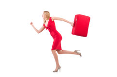 Blondie in red dress with suitcase isolated on Stock Photography