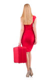 Blondie in red dress with suitcase isolated on Stock Image