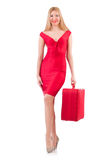 Blondie in red dress with suitcase isolated on Royalty Free Stock Image