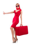 Blondie in red dress with suitcase isolated on. The blondie in red dress with suitcase isolated on white Royalty Free Stock Photo