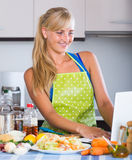 Blondie searching recipe in internet Royalty Free Stock Images
