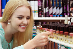 Blondie selecting lipstick in store Stock Images