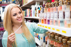 Blondie shopping in beauty store. Portrait of happy young blondie shopping in beauty store Royalty Free Stock Images