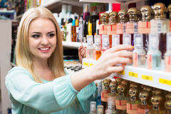Blondie shopping in beauty store Royalty Free Stock Images
