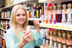 Blondie shopping in beauty store. Portrait of positive young blondie shopping in beauty store Stock Photo
