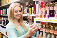 Blondie shopping in beauty store. Portrait of smiling young blondie shopping in beauty store Stock Image