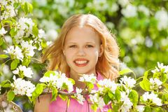 Blondie teenager girl with white pear tree flowers Royalty Free Stock Photos