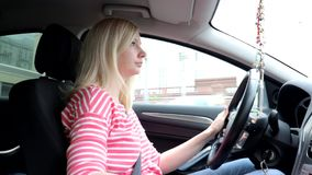 Blondie woman driving a car with manual gearbox.  stock video