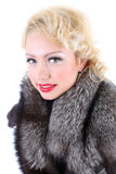 Blondie woman with fur collar Stock Image