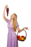 The blondie woman holding basket with fruits isolated on white Stock Photos