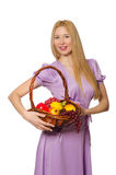 The blondie woman holding basket with fruits isolated on white Royalty Free Stock Image