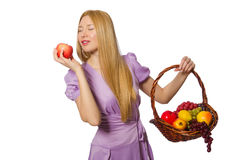 The blondie woman holding basket with fruits isolated on white. Blondie woman holding basket with fruits isolated on white Royalty Free Stock Image