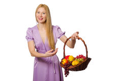 The blondie woman holding basket with fruits isolated on white Stock Photo