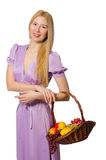 The blondie woman holding basket with fruits isolated on white. Blondie woman holding basket with fruits isolated on white Royalty Free Stock Photography