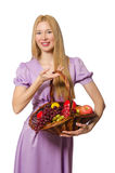 The blondie woman holding basket with fruits  on white Royalty Free Stock Photography
