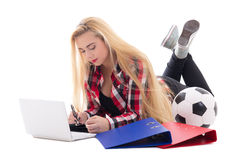 Blondie woman lying with laptop, folders and soccer ball isolate Stock Photo