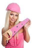 Blondie woman with pink tool Royalty Free Stock Image