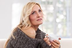 Blondie woman with an white-colored cup Royalty Free Stock Image
