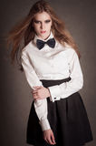 Blondie woman in white shirt and black bow-tie Stock Photo