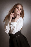 Blondie woman in white shirt and black bow-tie Royalty Free Stock Images