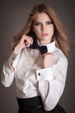 Blondie woman in white shirt and black bow-tie Royalty Free Stock Image