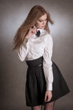 Blondie woman in white shirt and black bow-tie Royalty Free Stock Photography