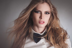 Blondie woman in white shirt and black bow-tie Royalty Free Stock Photo