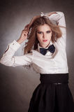 Blondie woman in white shirt and black bow-tie Royalty Free Stock Photos