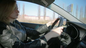Blondie young woman driving a car stock video footage