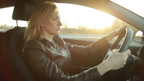 Blondie young woman driving a car stock footage