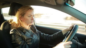 Blondie young woman driving a car stock video