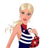 Blondin med en handväska Arkivbild