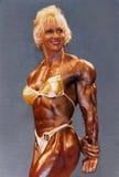 Blondine, Büffelleder, Bodybuilder Lizenzfreie Stockfotos