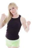 Blondine, die Fäuste zeigt lizenzfreie stockfotos