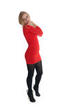 Blondine in einem roten Kleid Stockbild