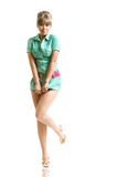 Blondine im grünen Kleid stockbild