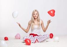 Blondine mit Ballonen Stockbilder