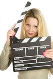 Blondine mit clapperboard Stockfoto